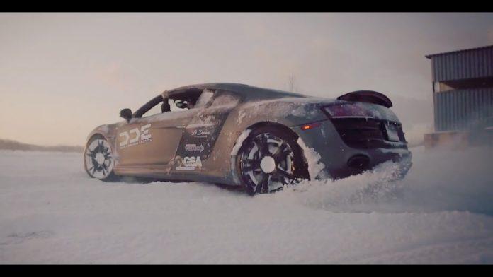 An Audi R8 and a Lamborghini Gallardo playing in the snow