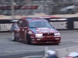An Alfa Romeo 155 GTA drifting on the track