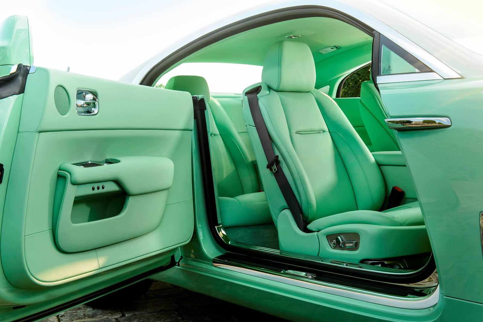 A Green Rolls Royce Wraith